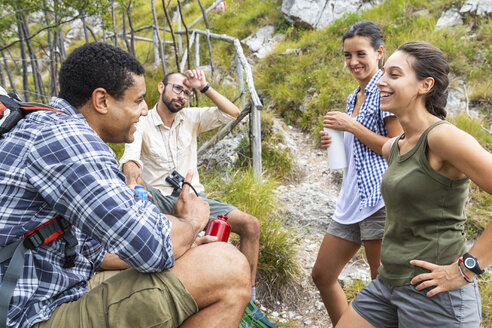 Italy, Massa, hikers taking a rest during a day in the Alpi Apuane mountains - WPEF00848