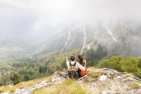 Italy, Massa, couple looking at the beautiful view in the Alpi Apuane - WPEF00866