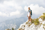 Italy, Massa, young woman on top of the mountain in the Alpi Apuane - WPEF00875