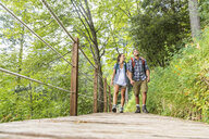 Italy, Massa, young couple hiking and walking on a boardwalk in the Alpi Apuane - WPEF00881