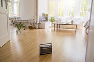Transistor radio standing on parquet in a modern living room - FMKF05300