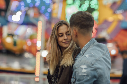 Young couple in love, embracing at a funfair - LHPF00098