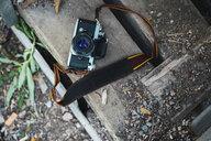 Camera on a wooden bench - KKAF02209