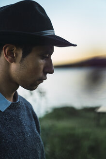 Portrait of a young man with hat at  a lake - KKAF02224