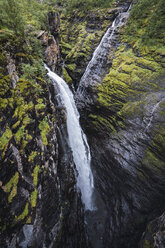 Norway, Lapland, North Cape, Waterfall at a cliff - KKAF02284