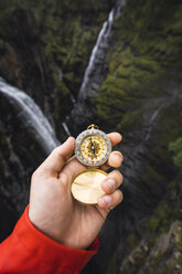 Hand holding a compass, Lapland, Norway - KKAF02287
