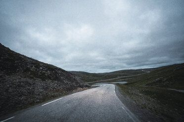 Norway, Lapland, North Cape, Winding road through the hills - KKAF02305