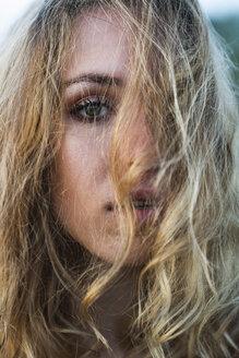 Close-up of beautiful blond young woman - KKAF02335