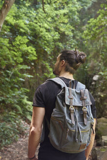 Spain, Canary Islands, La Palma, man walking with backpack in a forest - PACF00145