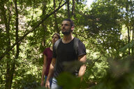 Spain, Canary Islands, La Palma, couple walking through a forest looking around - PACF00148