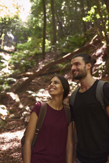 Spain, Canary Islands, La Palma, smiling couple standing in a forest looking around - PACF00154