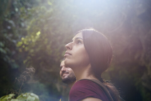 Spain, Canary Islands, La Palma, female hiker with boyfriend in a forest looking up - PACF00166