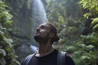 Spain, Canary Islands, La Palma, close-up of bearded man near a waterfall in the forest - PACF00169