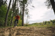Athlete mountainbiking in the woods - KKAF02374