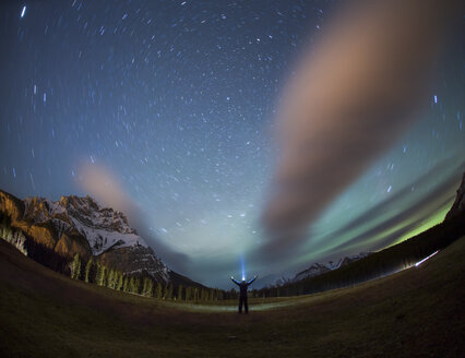 Person with headlamp under starry sky at night, Banff National Park, Alberta, Canada - AURF07664