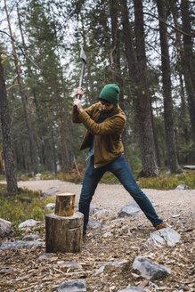 Man chopping wood in rural landscape - KKAF02394