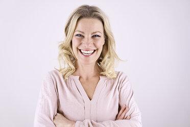 Portrait of smiling blond woman - PDF01789