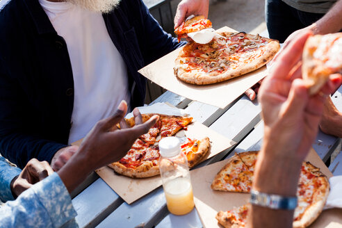 Friends having pizza outdoors - CUF44477