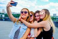 Friends taking selfie with smartphone - CUF44555