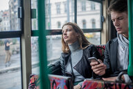 Couple commuting by bus, Budapest, Hungary - CUF44729