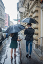 Couple with umbrella on morning commute, Budapest, Hungary - CUF44732