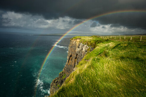 Cliffs of Moher, rainbow arching over cliff, Doolin, Clare, Ireland - CUF44855