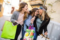 Friends out shopping and laughing in street - CUF45126