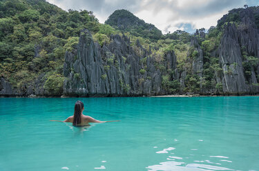 Woman in sea, Banga, Palawan, Philippines - CUF45135