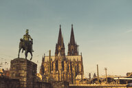 Germany, Cologne, view to equestrian sculpture of Wilhelm II, Cologne Cathedral and central station - DWIF00951