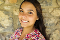 Portrait of smiling young woman - VABF01626
