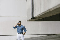 Bearded hipster businessman on the phone - FMGF00010