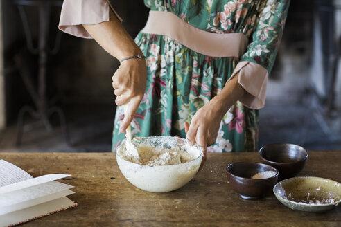 Young woman preparing cake dough, partial view - ALBF00596