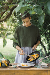 Young woman with homemade pumpkin gnocchis - ALBF00614