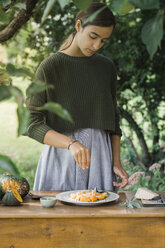 Young woman with homemade pumpkin gnocchi - ALBF00617