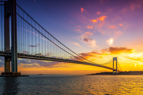 Suspension bridge over the sea during a colorful sunset - INGF00129