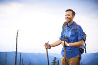 Portrait of smiling man during hiking trip - BSZF00688