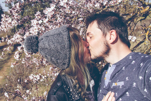 Portrait of a young couple kissing outdoors - INGF00193