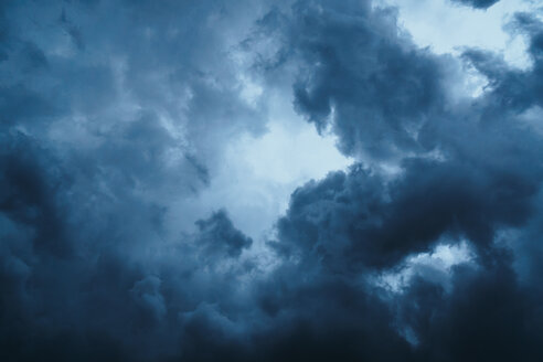 Low angle view of storm clouds in the sky - INGF00220
