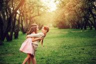 Two young girls on a grassy field - INGF00238