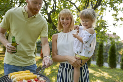 Family having a barbecue in garden - ZEDF01590