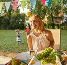 Happy woman on a garden party - ZEDF01647