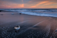 A diamond rock at sea during sunset in Iceland - INGF00323