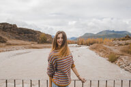Spain, portrait of happy young woman in Ordesa National Park - AFVF01635
