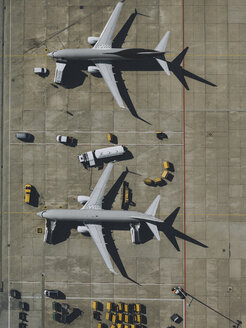 View from above commercial airplane being serviced, prepared on tarmac at airport - FSIF03189