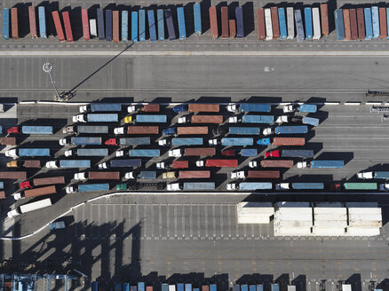 Aerial view semi trucks with containers in sunny shunting yard, Los Angeles, California, USA - FSIF03246