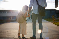 Father holding daughter's hand - CUF45314