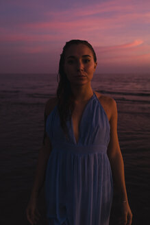 Portrait of young woman in front of the sea by sunset - MAUF01730