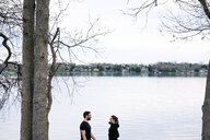 Couple relaxing by lake, Kingston, Canada - ISF19803
