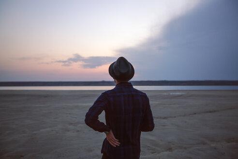 Man in hat on beach at sunset, Odessa, Ukraine - ISF19881