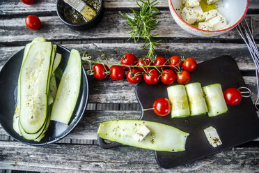 Vegetarian grill skewers, tomato and zucchini slices, rosemary garlic oil, sheep cheese - SARF03936